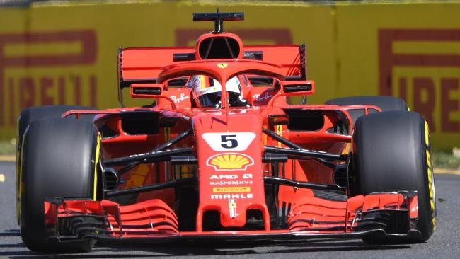 German driver Sebastian Vettel from the Ferrari team takes turn 6 during a practice session ahead of the Formula 1 2018 Australian Grand Prix at the Albert Park Circuit in Melbourne, Friday , March 23, 2018. (AAP Image/Joe Castro) NO ARCHIVING, EDITORIAL USE ONLY