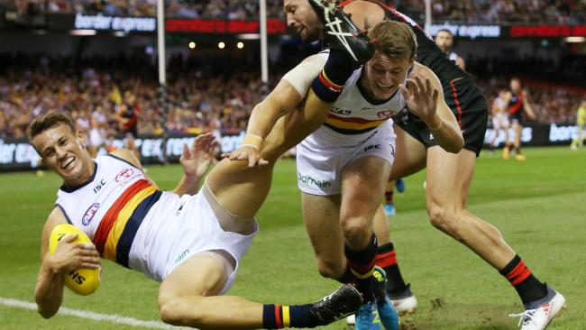 Adelaide's Tom Doedee collides with teammate Adelaide's Matt Crouch in the marking contest. Picture: Michael Klein