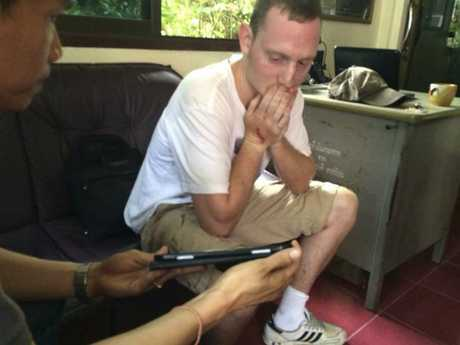 Christopher Ware, a friend of British tourist David Miller, who was killed along with his girlfriend, reacts during an investigation at a police station in the resort island of Koh Tao in the Gulf of Thailand.