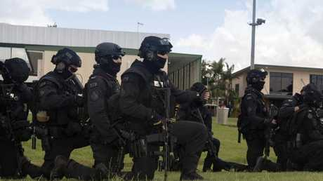 Queensland Police Service Special Emergency Response Team Tactical Operators prepare to conduct drill rehearsals for the 2018 Commonwealth Games.