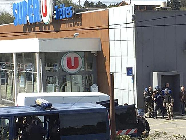In this image provided by Newsflare/Tarbouriech Roseline police gather outside a supermarket in Trebes, where people were taken hostage. Picture: Newsflare/Tarbouriech Roseline via AP.