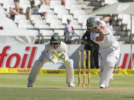 AB de Villiers smashes the ball away off the bowling of Nathan Lyon. (AP Photo/Halden Krog)