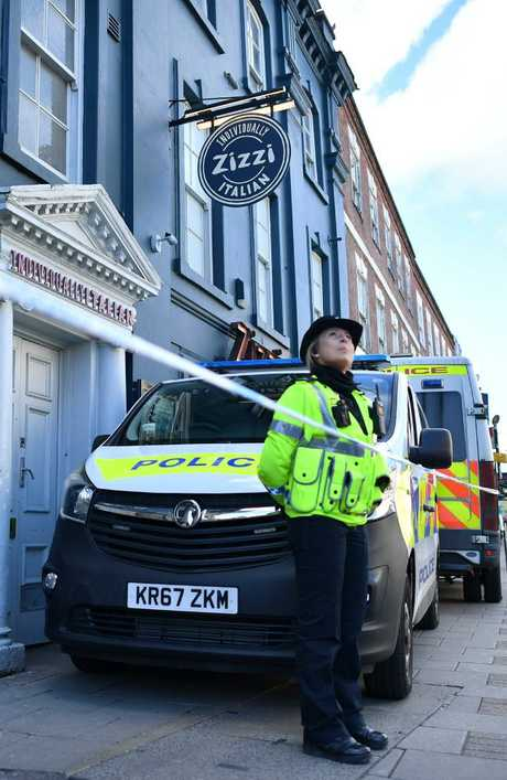 A police officer stands guard outside a cordoned-off branch of the Italian chain restaurant Zizzi. Picture: AFP