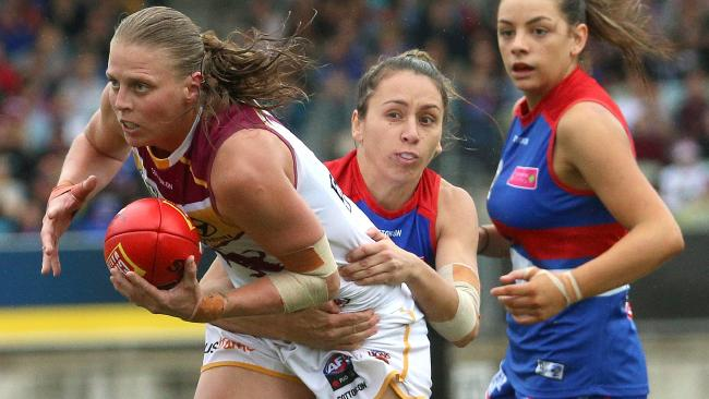Kate Lutkins is tackled by Angelica Gogos during the AFLW Grand Final.