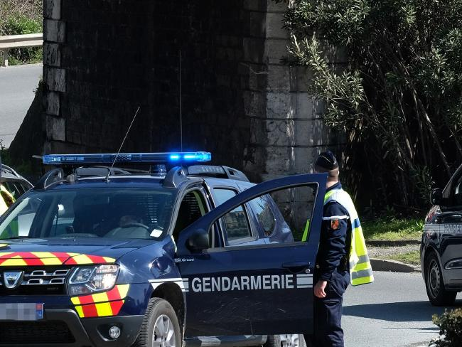 French gendarmes block an access to Trebes, where a man took hostages at a supermarket and two people died. Picture: AFP PHOTO / ERIC CABANIS