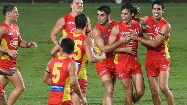 Jack Bowes (2nd right) of the Suns celebrates after scoring a goal during the round one AFL match between the Gold Coast Suns and the North Melbourne Kangaroos at Cazaly's Stadium on March 24, 2018 in Cairns, Australia. (Photo by Ian Hitchcock/Getty Images)