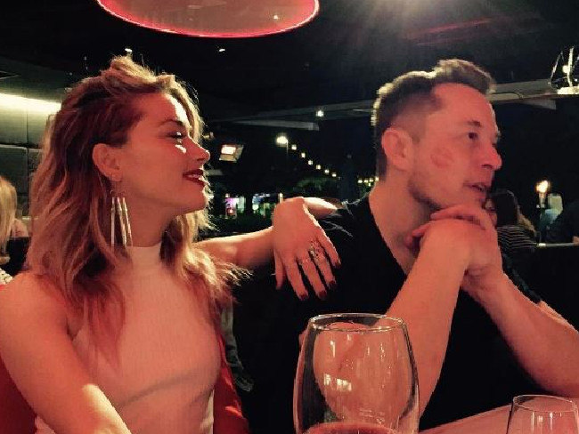 Elon Musk with ex-girlfriend, actress Amber Heard.