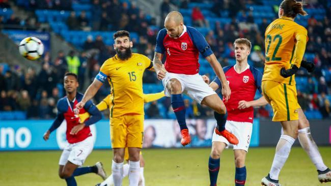Mile Jedinak couldn't stop Tore Reginiussen scoring Norway's second.