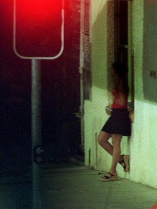 Prostitute on the Valley's notorious corner, Brunswick and Harcourt streets.