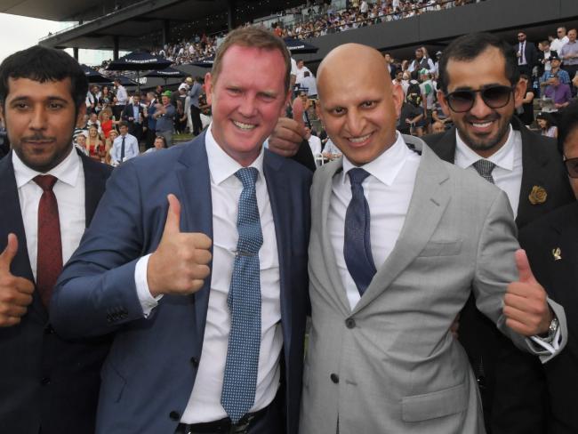 Trainer Michael Hawkes (second left) after Estijaab's dominant Slipper win. Picture: Simon Bullard