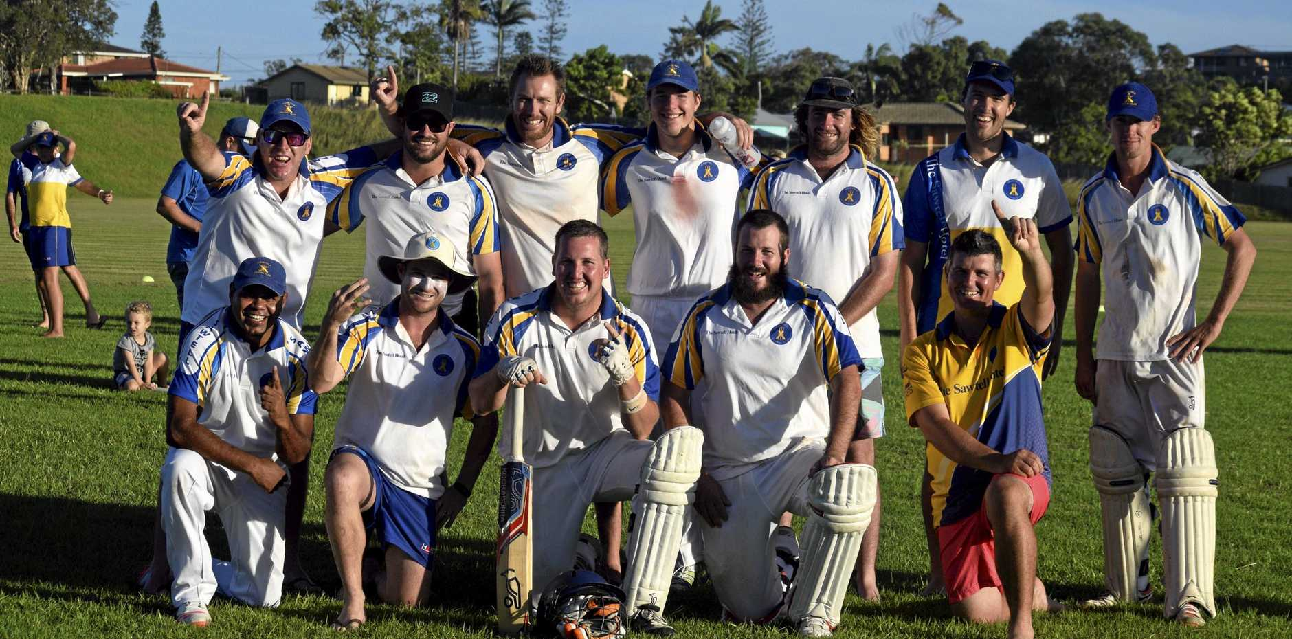 The Sawtell players celebrate winning the CHDCA first grade cricket grand final against Nana Glen.