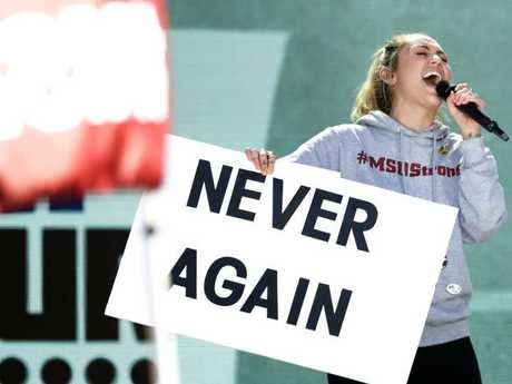 Miley Cyrus performs as close to a million people attended the March for Our Lives  in Washington alone. Picture: Chip Somodevilla/Getty Images/AFP