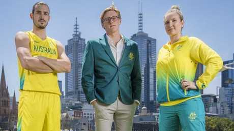 Chris Goulding, Mack Horton and Melissa Tapper unveiling the Australian uniforms. Picture: Jason Edwards