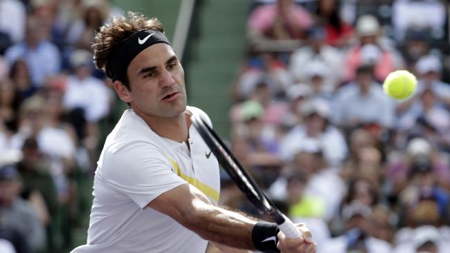 Roger Federer returns to Thanasi Kokkinakis. (AP Photo/Lynne Sladky)