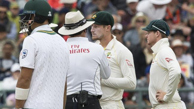 Cameron Bancroft talks to the umpire on the third day. (AP Photo/Halden Krog)