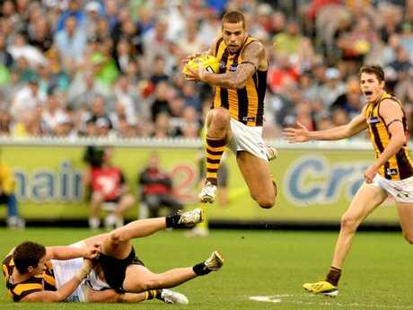 Lance Franklin leapfrogs fallen players on the way to a monster goal against Collingwood in 2013.