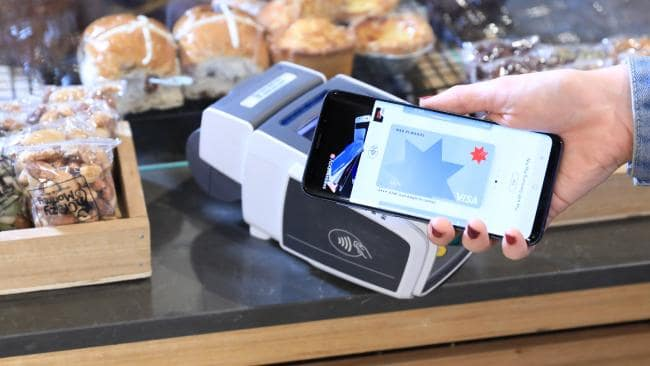 A customer using Samsung Pay at the checkout.