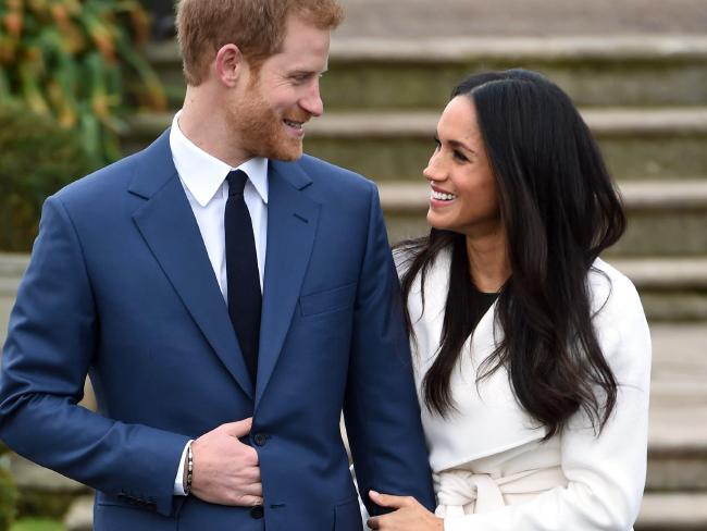 Meghan Markle was clearly more comfortable with the public aspect of her relationship with Prince Harry than his former girlfriends. Picture: Eddie Mulholland / Pool via AP