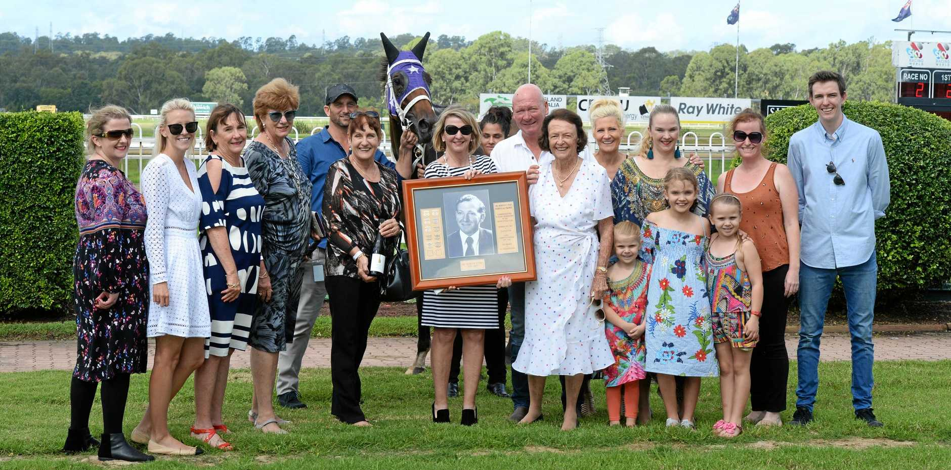 FINE RESPECT: The family of Dr Mervyn Fish share a moment together after It's Choux Time won the Dr Mervyn Fish Memorial Maiden at Bundamba Racetrack.