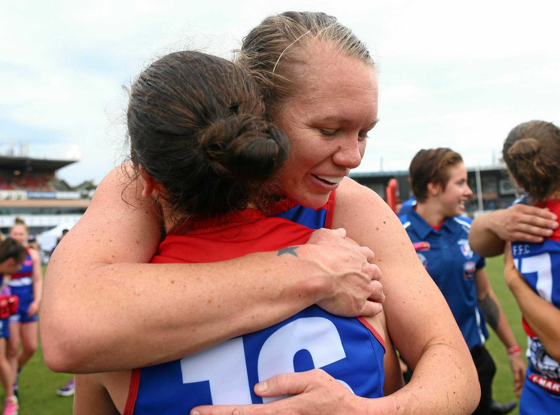 MILESTONE: Sunshine Coast's Aasta O'Connor hugs Naomi Ferres of the Bulldogs after the AFLW Grand Final match between the Western Bulldogs and the Brisbane Lions at Ikon Park.