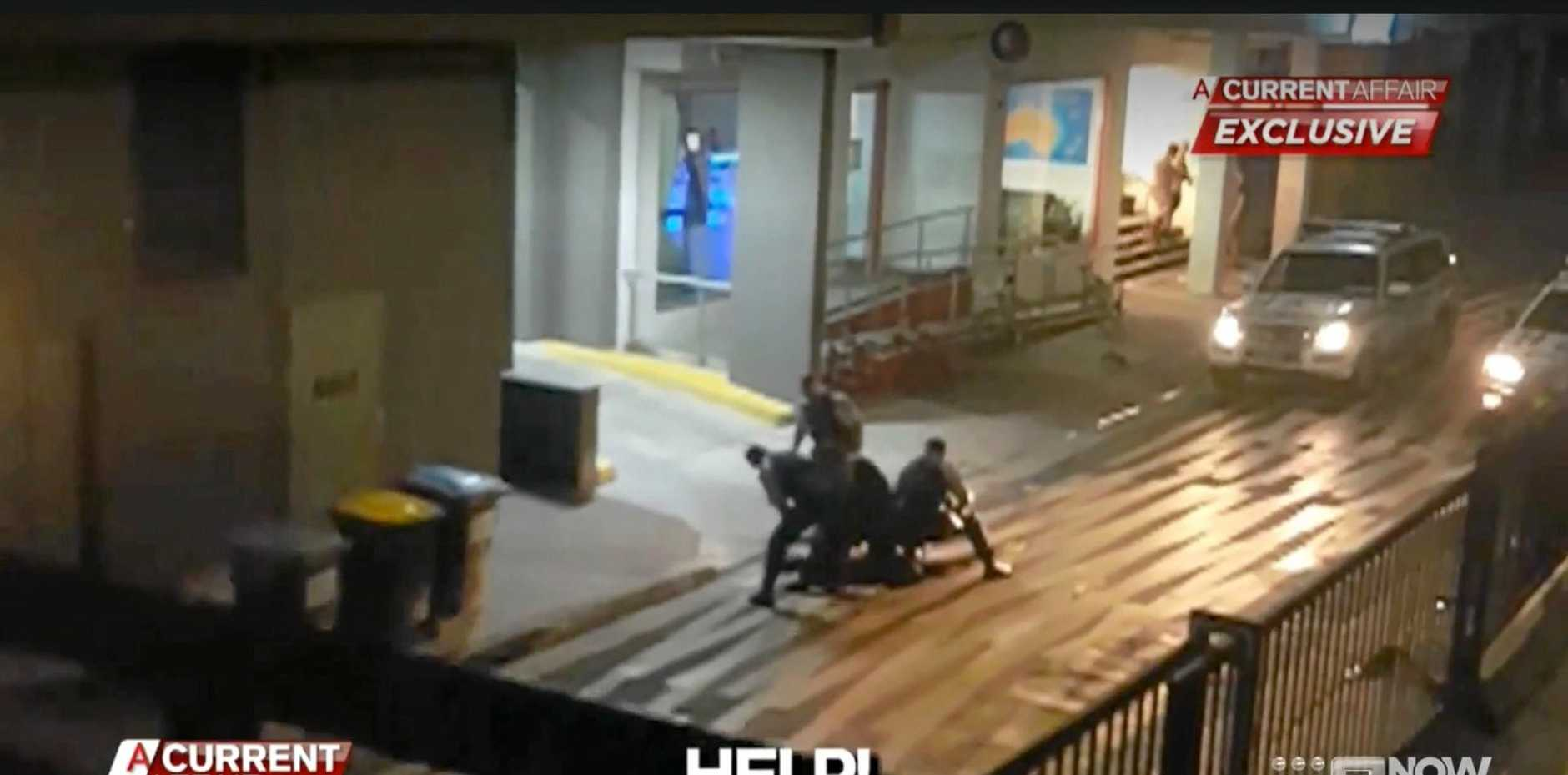 Footage from A Current Affair of the police arrest at Lateen Lane, Byron Bay.