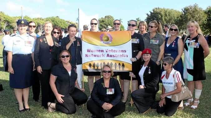 WALK PROUD: Members of the Townsville branch of the Women Veterans Network Australia gather under the banner which female veterans from Toowoomba and across the nation are being urged to march behind this Anzac Day.