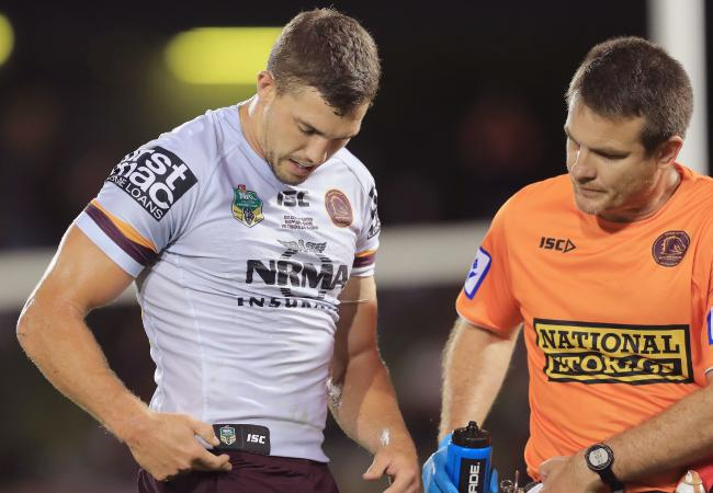 Corey Oates of the Broncos goes off the field with a hip injury.