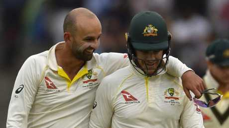 Nathan Lyon and Tim Paine on day three — before the cricket world caved in. (Photo by Ashley Vlotman/Gallo Images/Getty images)