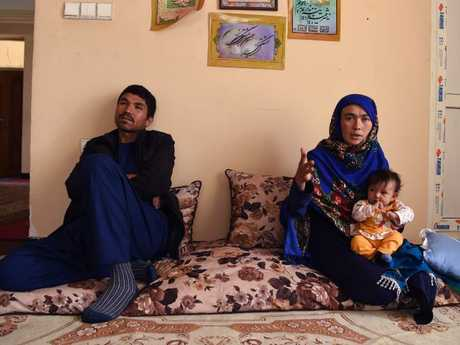 Afghan mother Jahantab Ahmadi holds her youngest child as her husband Musa Mohammadi looks on at a house in Kabul. Picture: AFP