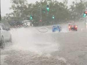 Flash flood smashes south-east, heavy rain threatens Coast