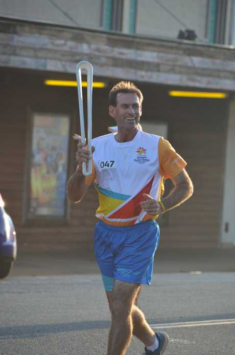 Paul Clegg runs the Queen's Baton Relay in Kingaroy on March 27, 2018.
