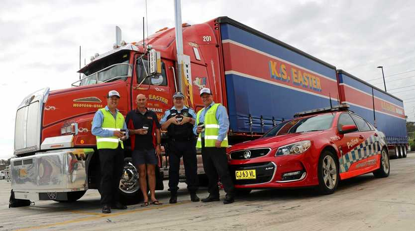 Police tell truckies that they're appreciated during an informal forum at BP Eastern Creek.