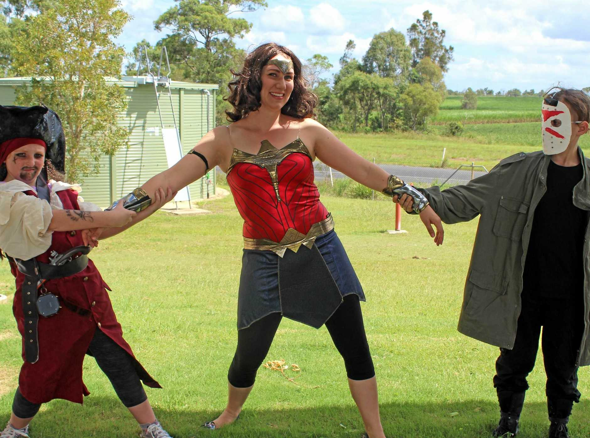 SUPERHEROES VS VILLANS: Student Debbie Simmonds, 11, Carinity Education Middle School teacher and co-ordinator Maddie Brown and student Brandon Ross, 10.
