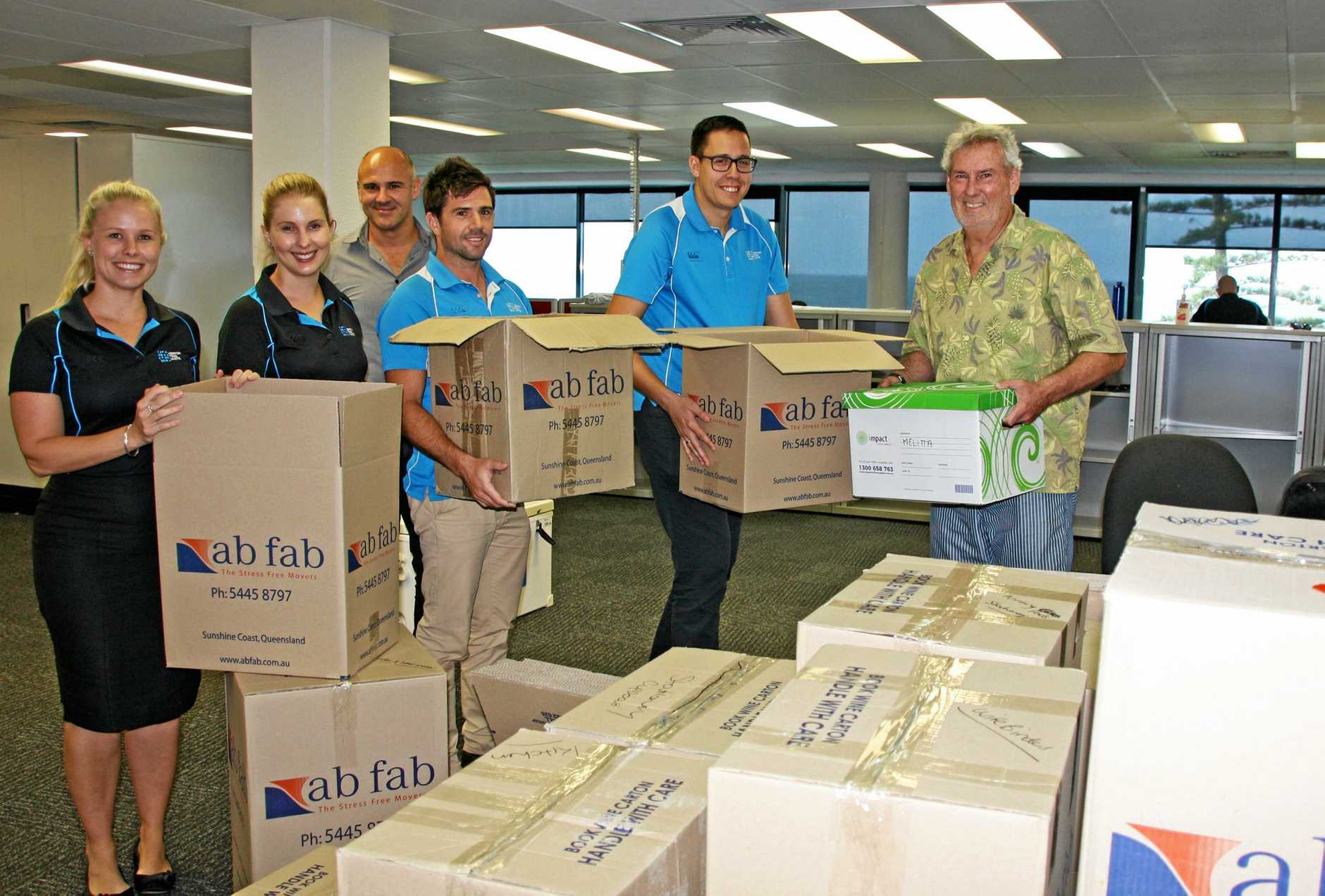 MOVING DAY: HTW Sunshine Coast's Melitta McDonald, Stacey Sager, Stuart Greensill, Scott Radmall, Duane Gilliland and Peter Degotardi pack up in readiness for the move to Maroochydore.