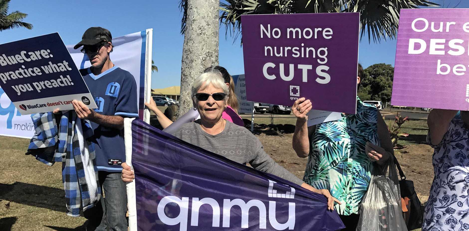 HARD-PRESSED: Rosaleen Nicholls protests Blue Care's staff cuts last year.