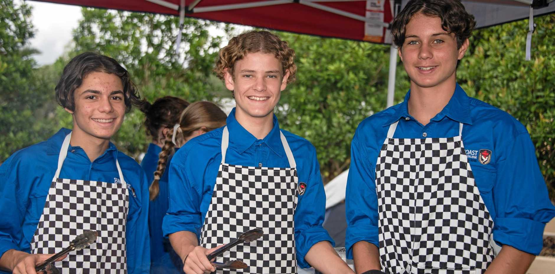 ON A MISSION: The boys hit the tongs for the barbecue at the official launch of the Suncoast Christian College trailer for Outback Link.
