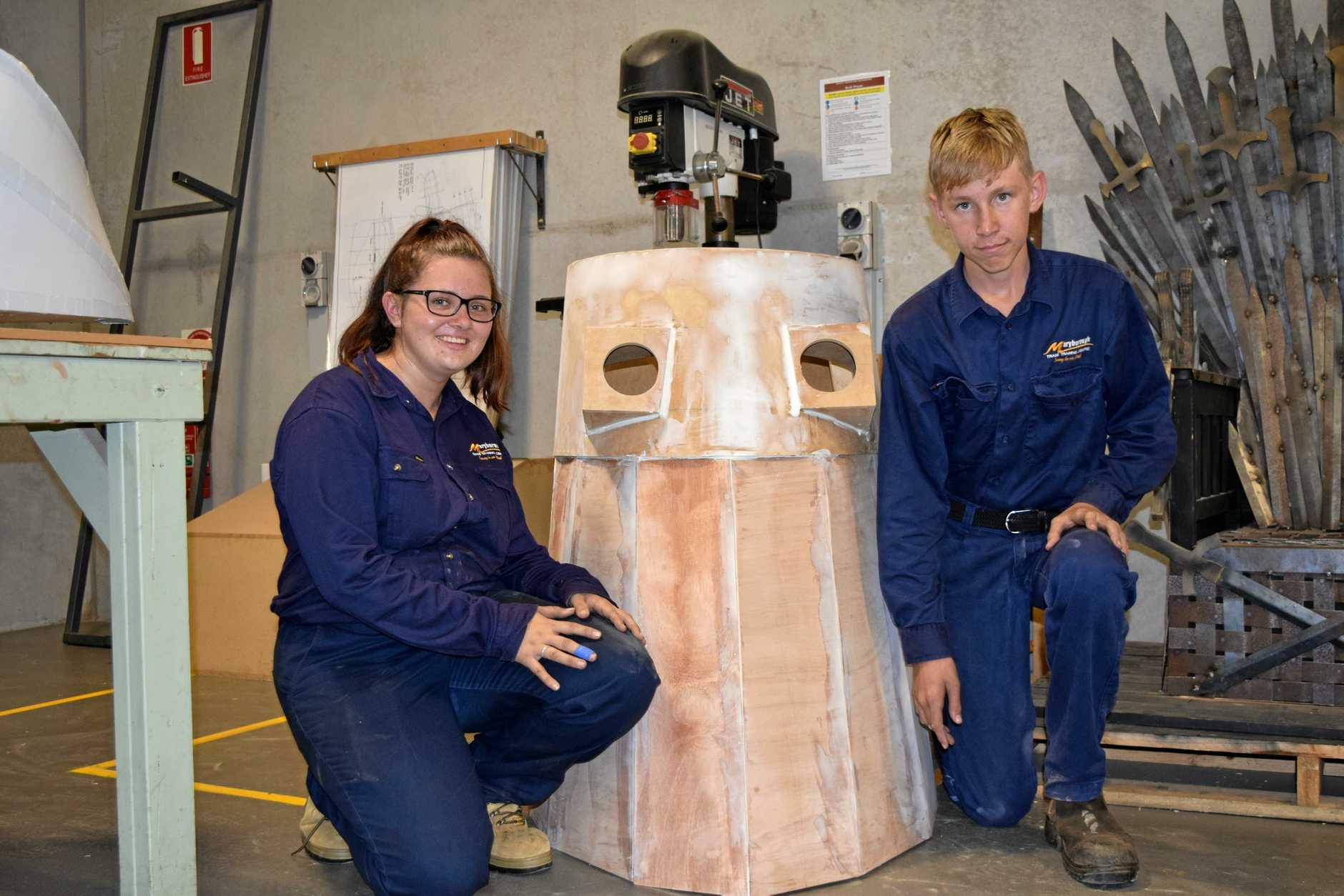 EXTERMINATE, EXTERMINATE: Maryborough State High School students Zoe Golchert and Declan Parker working on the Dalek that will debut at this year's FraserPop Pop Culture Festival.