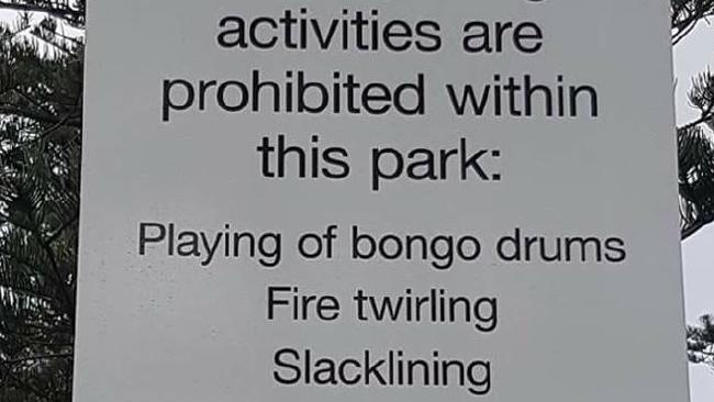 Burleigh locals are outraged after a sign banning bongo drums and fire twirlers popped up in the park. Photo: Facebook