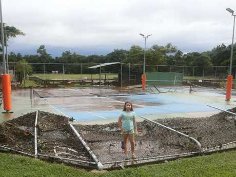 Junior player Mia Christopher, 11, isnt too happy about the damage to her local tennis courts. Picture: Justin Brierty