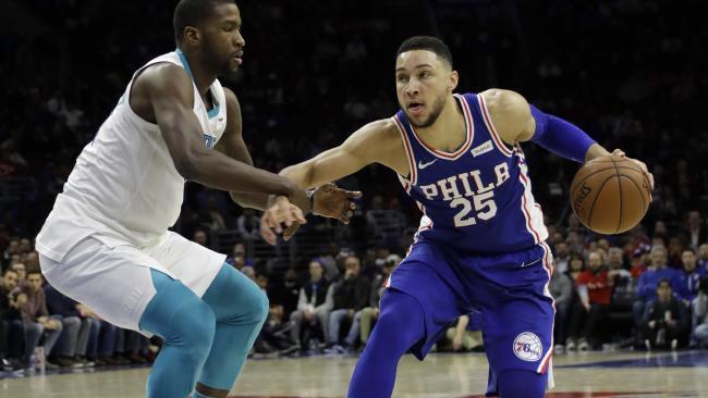 Philadelphia 76ers' Ben Simmons, right, dribbles past Charlotte Hornets' Michael Kidd-Gilchrist during the second half of an NBA basketball game, Monday, March 19, 2018, in Philadelphia. (AP Photo/Matt Slocum)