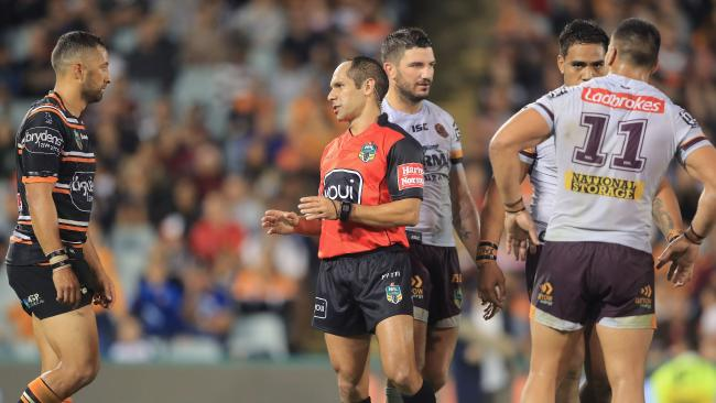 Referee Ashley Klein talks to Tigers Captain Benji Marshall after he awarded a penalty.