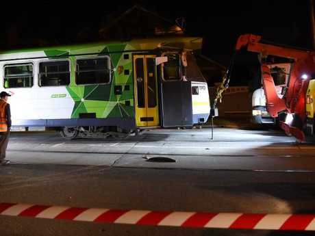 The tram is towed pulled back onto the tracks. Picture: Nicole Garmston