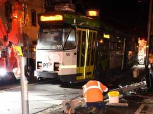 Tram derails and slams into bus shelter