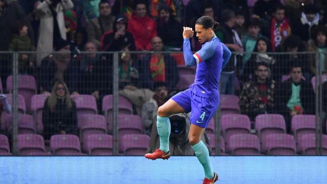 Netherlands' defender Virgil van Dijk celebrates scoring his team's third goal