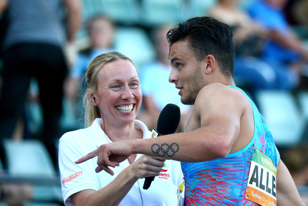Devon Allen of the United States of America speaks to former Olympian Tamsyn Lewis after winning the Men 100m during the Australian Athletics Sydney Grand Prix.