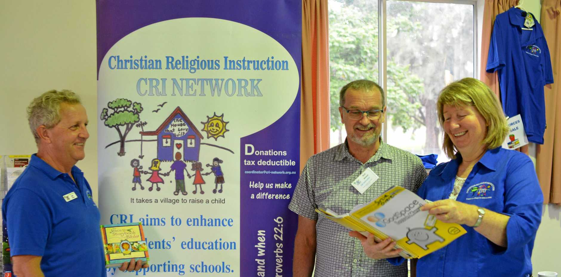BRUSHING UP: (L-R) CRI Network's Carl Howard, Pastor Rick Armour and Suzie Overell at Gatton's Christian Life Centre.