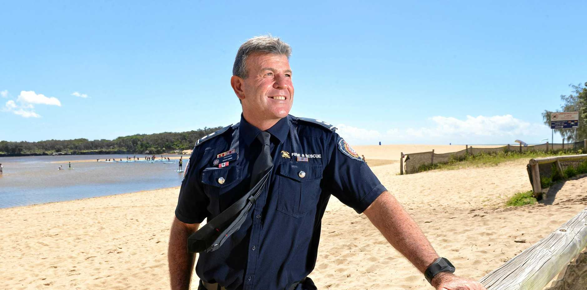 HERO: Sunshine Coast firefighter Brian Lemke has been awarded for his bravery rescuing a girl jumping from a building.