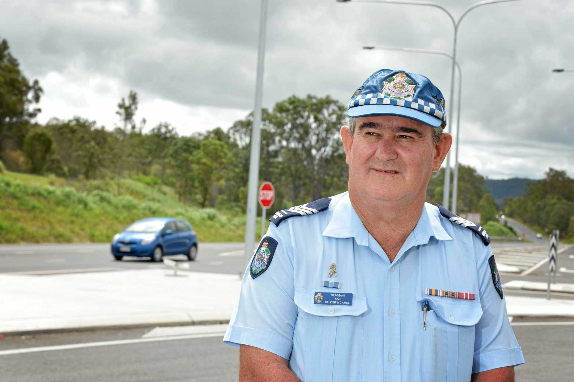 Sergeant Steve Webb at the Gunalda service station near Gympie after a fatal car accident.