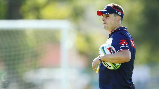 Coach Dave Wessels instructs the Rebels during a training session.
