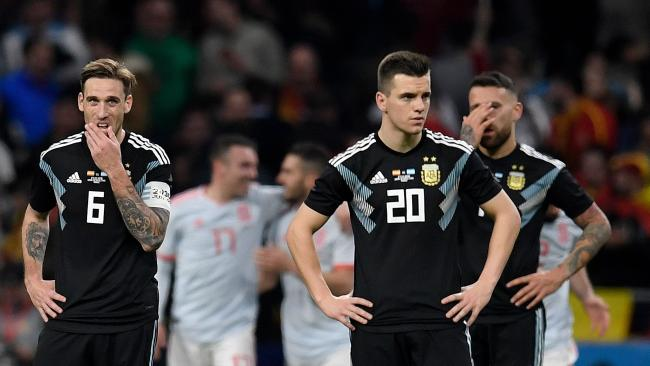Left to right: Argentina midfielders Lucas Biglia and Giovani Lo Celso and defender Nicolas Otamendi react after Spain's sixth goal.
